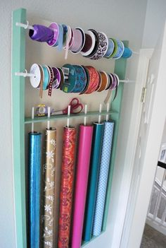 Wrapping paper and ribbon storage. DIY Behind The Door Wrapping Station Diy Wrapping Paper Organizer, Ribbon Organization, Craft Organization, Diy Organizer, Organization Station, Craft Storage, Diy Home, Home Crafts, Home Projects