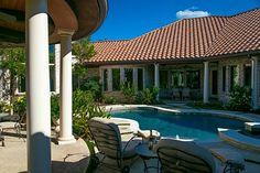 This Mediterranean home wraps around the pool...