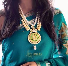 Make a style statement with this extravagant neckpiece in green, gold and pearls. Available at Joules by Radhika. #joulesbyradhika #style #jewellery #statementjewellery #extravagant #designer #geeen #gold #pearls
