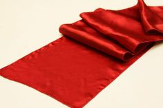 14 inch x 108 inch Red Satin Table Runner by KS Designs. $9.75. 100% polyester. Washer and dryer friendly. Do not bleach. In addition to table runners, we offer; cloth napkins, table linens, chair cover, sashes, table-skirt, rectangular tablecloth, round tablecloth, square and round overlays. Available in a variety of colors and fabrics, these high-quality products are the ideal finish to your table that you've been searching for. If you have questions about any ...