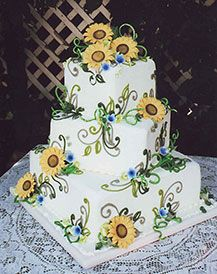 My wedding cake was like this - Black-eyed Susans and blue Chicory, but the flowers were real. It brings back memories.
