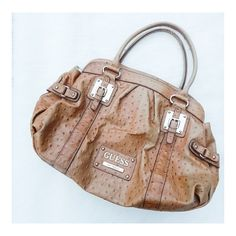 """• Guess Handbag • Beautiful tan, leather handbag with gold features. Preloved, with some light stains inside. Inside zipper and pocket compartments. About 12"""" length. Guess by Marciano Bags Shoulder Bags"""
