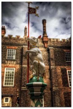 Heraldic Beasts-Hampton Court Palace-EXCERPT: 'Some of the most characteristic features of Tudor gardens were carved heraldic beasts and animals mounted on the top of tall poles, representing the strong underlying themes of fantasy and heraldry. These figures of heraldic beasts or 'Bestes' were also found on house gables, roof lines, gateposts, banners and even on top of tents.'