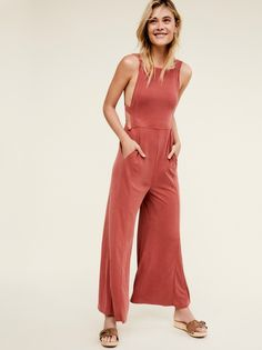 Trip Me Up Jumpsuit | Soft ribbed jumpsuit featuring an open back with adjustable tie detailing.    * Dropped armholes   * Hip pockets   * Flared legs