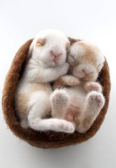 READY TO SHIP! Rabbits/ bunnies are animals that I just love to make! These two little babies sleep in a nest of of wool. The bunnies are each life size babies that fit in your hand. They are not attached to each other or the nest and can be taken out. But a warning, much handling #feltanimalsdiy