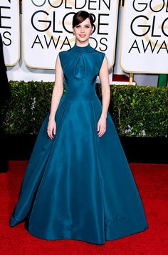 Felicity Jones wearing a blue Christian Dior gown and Van Cleef & Arpels jewelry at the 72nd Annual Golden Globes