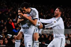<a gi-track='captionPersonalityLinkClicked' href=/galleries/search?phrase=Cristiano+Ronaldo+-+Soccer+Player&family=editorial&specificpeople=162689 ng-click='$event.stopPropagation()'>Cristiano Ronaldo</a> (L) of Real Madrid CF celebrates with his team-mates <a gi-track='captionPersonalityLinkClicked' href=/galleries/search?phrase=Alvaro+Arbeloa&family=editorial&specificpeople=3941965 ng-click='$event.stopPropagation()'>Alvaro Arbeloa</a> (C) and Sergio Ramos after scoring his team's their…
