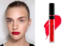 """The trick to pulling off a deep red lip? According to Maybelline's global makeup artist Yadim, it's all about balance. To offset the textured lips he created at Jason Wu's spring show, he kept the rest of the face natural. And for the lip color itself, he layered a blue-based red and an orange-y red, both from Maybelline's new Vivid Matte collection. For a similar look, try BH Liquid Lipstick in """"Glory"""", $8; bhcosmetics.com."""