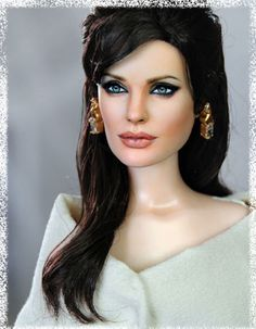 """www.ncruz.com. The doll guy!! He repaints celebrity """"Barbie"""" type dolls so they actually look like the celebrities. Incredibly life-like! Commissions start at $1,000"""