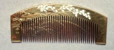 Gold lacquered wood comb.  pearl inlay depicting rice plant.  late Edo.era.  Powerhouse Museum Collection