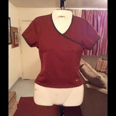 """Nike Top Nike Workout Top is made of 88% Polyester and 12% Spandex. Fits nice and is Super Comfortable. The Color is Brown with green accents. Size Medium (8-10). Laying flat """"15.5. Length """"20.5. This item is in Good condition, Authentic and from a Smoke And Pet free home. All Offers through the offer button ONLY. I Will not negotiate Price in the comment section. Thank You Nike Tops"""