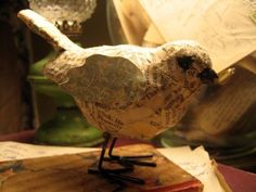 Dollar store bird...covered in old book pages. I love it.