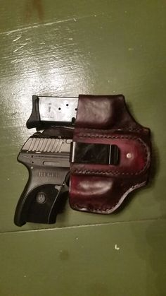 Custom handmade leather holster with attached magazine carrier. Pictured with Ruger LCP
