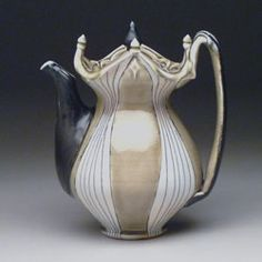 "Lorna Meaden, Teapot, 2011  soda-fired porcelain  9"" x 6"" 5"""