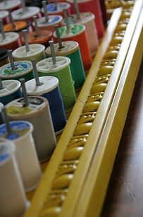 Nails and a vintage frame are an organized way to keep your sewing thread nice and neat. | 51 Game-Changing Storage Solutions That Will Expand Your Horizons