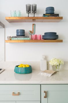 Mint kitchen cabinets, white counter, open shelving, hammered copper shelves, pretty kitchen with vintage touches