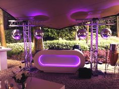 Outdoor DJ Setup. Mirrorballs, T- truss construction, white DJ booth with LED. Wedding party