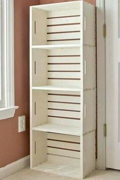 4 unfinished crates from a craft store spray painted white, tacked together and bolted to the wall