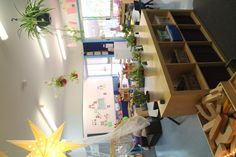 Natural colour scheme, lamps and plants in the classroom at Goodstart Red Hill. - i adore the hanging plants!