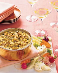 Baked Artichoke Dip  - lightened up when served with veggies instead of bread. Yum!