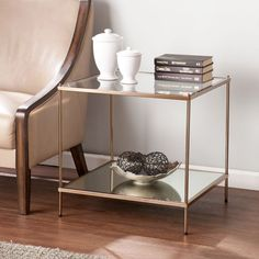 Himerope Iron End Table.Shimmer with the stars on the Walk of Fame with this glamorous end table. Sleek metallic gold melts into a reflective mirrored shelf and luminous glass tabletop for high shining style. Table Table lines Room – Furnituremaxx Glass End Tables, Selling Design, Mirror With Shelf, Gold Glass, Home Living, Apartment Living, Living Spaces, Living Rooms, Console Table