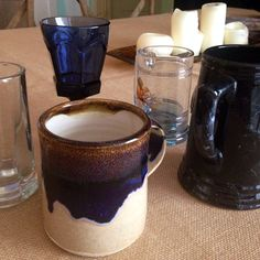 """A selection of """"tankards"""" for guests to take home with them. About $1 each from Goodwill."""