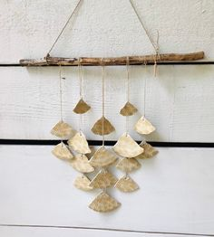 A waterfall of beige ceramic fans, attached to a branch with flax cord. Handmade Ornaments, Glazed Ceramic, Art Of Living, Wind Chimes, Anniversary Gifts, House Warming, Eye Candy, Kids Room, Waterfall
