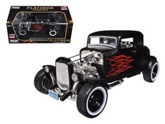 1932 Ford Hot Rod Matt Black with Flames Limited Edition / Platinum Collection 1/18 Diecast Model Car by Motormax - Brand new 1:18 scale car model of 1932 Ford Hot Rod Matt Black with Flames Limited Edition / Platinum Collection die cast car model by Motormax. Brand new box. Rubber tires. Steerable wheels. Has opening doors. Detailed interior, exterior. Dimensions approximately L-8, W-4, H-3.5 inches. Please note that manufacturer may change packing box at anytime. Product will stay exactly…