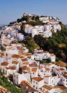 I'd love to walk up the hill in this village in Andalusia, Spain.