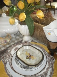 ...mustard mats and brown transferware, yellow tulips, on beige check cloth