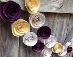 This garland is made of high quality paper in beautiful rich purple / plum with rich gold tones and ivories. Each paper rose is hand cut and sculptured and measures between 2 and 2 1/2 inches, they're