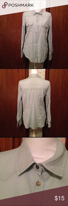 Denim Long Sleeve Button Down Long sleeve button down. Double pockets on breast area. Cute small buttons.  100% Cotton. Machine wash cold water on gentle cycle. Line Dry. Extra button on tag. Excellent Condition. Garage Tops Blouses