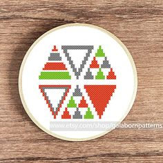 Tittle: Triangles warm.    This PDF counted cross stitch pattern available for instant download.    Skill level: Beginner.    Floss: DMC
