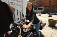 Big Ang, the owner of two Drunken Monkey bars, takes a seat on a motorcycle on Front Street in Brooklyn. Raiola opened two bars, one in Staten Island and one in Miami, and opened a third one in Brooklyn.