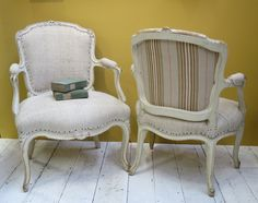 Pair French Bergeres covered with heavy antique linen and old ticking on back. www.appleyhoare.com