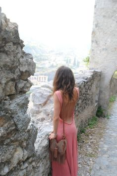 Travel. In a backless dress.