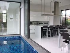 Singapore Villa Designer Lacquer Kitchen by: Tecnocucina, like opening door to outside/pool