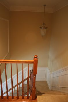 Chair rail up the stairs and shadow box details..... example without railings painted yet