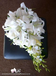 white-lily-trailing-bouquet by Blossom Wedding Flowers, Bridal Flowers, Flower Bouquet Wedding, Floral Wedding, Purple Flowers, White Flowers, Trailing Bouquet, Cascade Bouquet, Cascading Bouquets, Bride Bouquets
