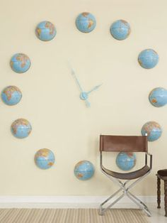 Worldly Wall Mural-DIY wall clock using globes- I want to do something similar to this in our family room. Saw a cool one where each number was a small old fashioned clock, too.  Have to start thinking about interesting ways to make this our own...