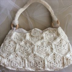 Crochet white handbag from hexagons with a lot of beads