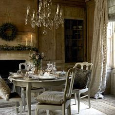 The natural wood is a gorgeous backdrop to this elegant silver and cream dining room.