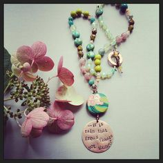 "Handstamped copper pendant reads: ""....it is rain that grows flowers not thunder"" Part of a beautiful Rumi quote. Polymer flower tab focal- Humblebeads Faceted prehnite Glass Pink Opal Czech glass LInen Cording Copper toggle ring, and handmade beaded toggle bar Measures 21 inches"