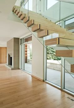 Never seen another modern staircase quite like this wood and glass beauty