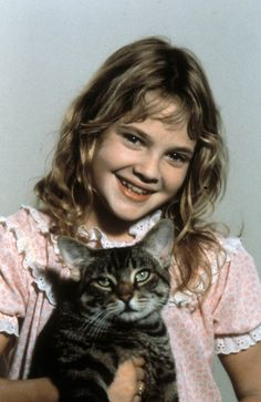 Drew Barrymore - with cat from Cat's Eye - awesome movie! :)