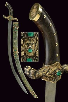 B§ [ PRESENTATION SABRE Wooden scabbard with ray skin covering, with gilt silver mounts, engraved and sculpted with lion heads and enriched with malachite and pink cabochon stones. Two suspension rings. Swords And Daggers, Knives And Swords, Saber Sword, Gold Caps, Fantasy Weapons, Cold Steel, Green Stone, Rare Antique, Coat Of Arms