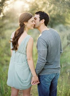 Kiss on the cheek. Walking away. Holding Hands. Portrait. Couple.