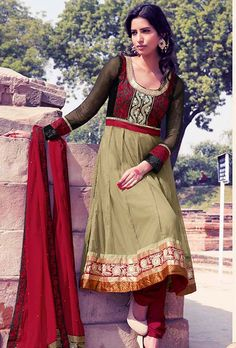 Dreamy variation on shape and forms compliment your style with tradition.   The dazzling black and dusty green net churidar suit have amazing embroidery patch work is done with resham, zari and stone work.   Beautiful embroidery work on kameez is stunning.   The entire ensemble makes an excellent wear.   Contrasting red santoon churidar and red chiffon dupatta is available with this suit.   Slight Color variations are possible due to differing screen and photograph resolutions.