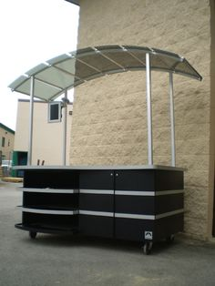 coffee vendor cart. Designed with storage area, retail display and light weight upright canopy. www.Cart-King.com