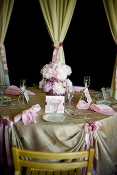 Tablescape.  Love the ribbon tucking up the tablecloth idea!